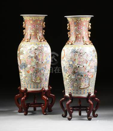 A PAIR OF FAMILLE ROSE PARCEL GILT ENAMELED EXPORT PORCELAIN FLOOR VASES ON STANDS, ATTRIBUTED TO