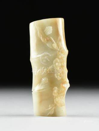 A SCHOLAR'S CELADON JADE WRIST REST, CHINESE, ATTRIBUTED TO THE LATE QING DYNASTY (1644-1912),