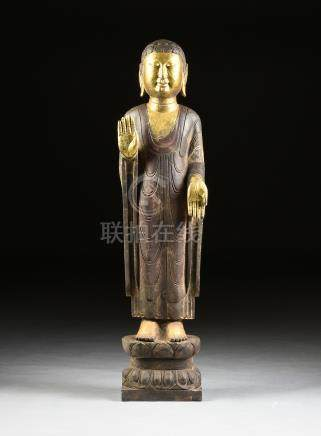 A PARCEL GILT BLACK MARBLE ABHAYAMUDRA STANDING BUDDHA OF BLESSING AND PROTECTION, CHINESE, in the