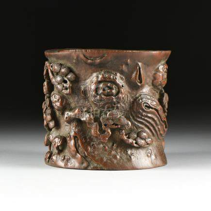 A LARGE CHINESE CARVED BAMBOO BRUSH POT, 20TH CENTURY, the shaped cylindrical bamboo stalk body with