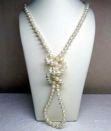 Sautoir en perles de culture naturelles  (D: 7 - 7,5  mm) un nœud entre chaque