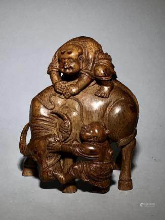 A Carved Bamboo Buffalo and two boys