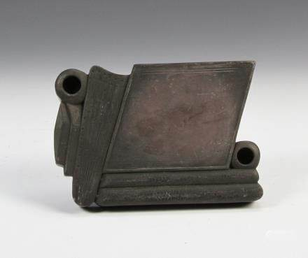 19th C. Ink stone, in a geometric form, with incised lines and two openings on opposite ends