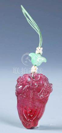 A CHINESE  PINK TOURMALINE CARVED ZHAIJIE PENDENT