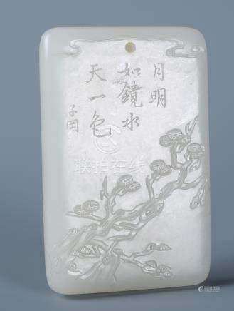 A CHINESE WHITE JADE LANDSCAPE INSCRIBED PENDANT PLAQUE