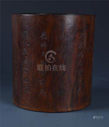 AN INSCRIBED CYLINDRICAL HUANGHUALI BRUSH POT