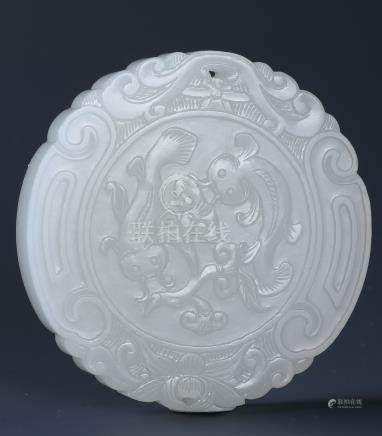 A WHITE JADE CIRCULAR PLAQUE OF TWO FISHES