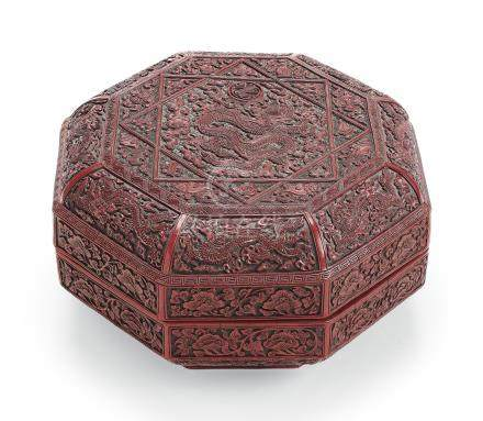 A CARVED RED AND BLACK LACQUER OCTAGONAL BOX AND COVER