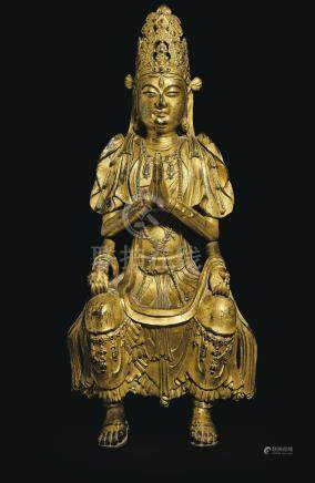 A HIGHLY IMPORTANT AND EXTREMELY RARE GILT-BRONZE FIGURE OF A MULTI-ARMED GUANYIN