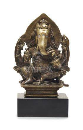 A SILVER-INLAID BRONZE FIGURE OF GANESHA