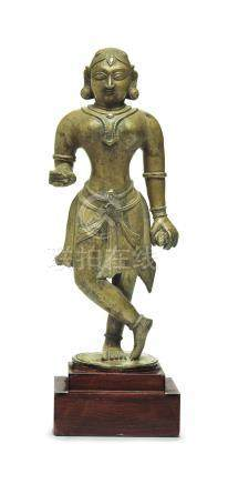A BRONZE FIGURE OF DEVI