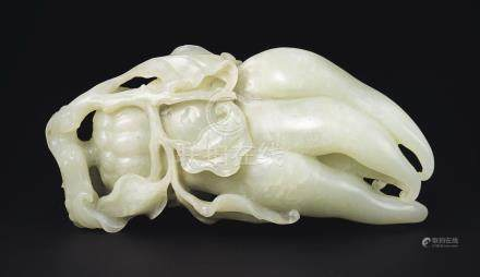A PALE GREENISH WHITE JADE CARVING OF A ''BUDDHA'S HAND'' CITRON