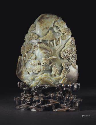 A LARGE INSCRIBED BROWN AND GREY JADE BOULDER