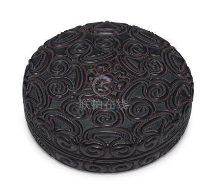 A LARGE BLACK TIXI LACQUER CIRCULAR BOX AND COVER