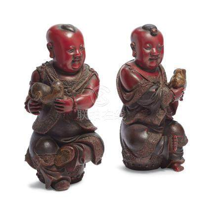 A PAIR OF POLYCHROME-LACQUERED WOOD FIGURES OF BOYS