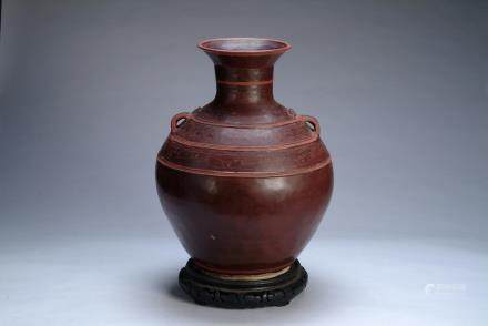 A CHINESE POTTERY TWO HANDLED JAR