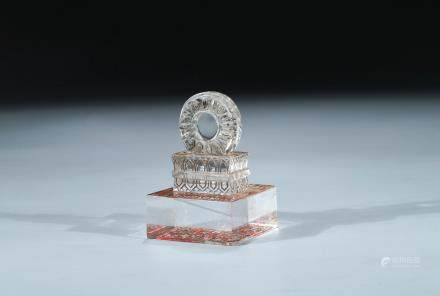 A CRYSTAL CARVED 'DHARMACHAKRA' SEAL