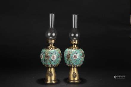 A PAIR OF BRONZE ENCASED FAMILLE ROSE OIL LAMPS