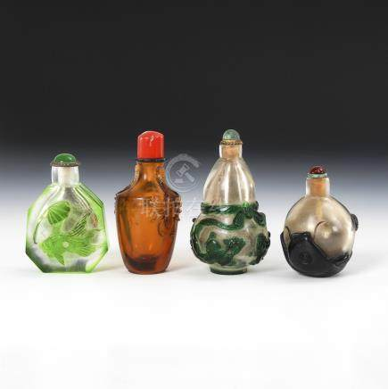 4 Snuffbottles - Glas mit Tierdarstellungen.Four Glass Snuff Bottles decorated with Animals and