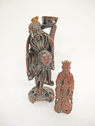 Two Chinese carved hardwood figures H35cm and H20cm (2)