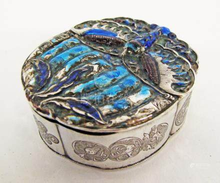 A Chinese silver and enamel pill box circa 1900, of lobed form, the domed cover with enamelled