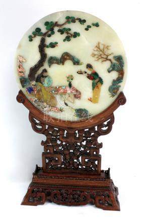 A 20th century decorative Chinese screen with hardstone inlay and mounted on a pierced wooden frame,