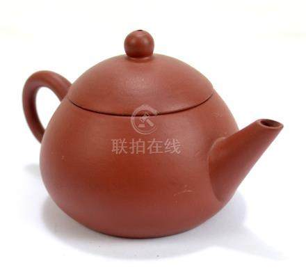 A Chinese Yixing teapot with four character seal mark to base, length 13cm.