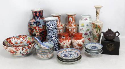 A group of Chinese and Japanese ceramics including sleeve vase painted in underglaze blue with two