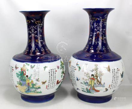 A pair of large modern Chinese decorative vases, the central white ground panels decorated with
