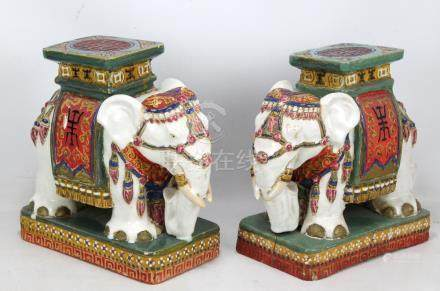 A pair of Chinese stoneware elephant stools (one af), height 33cm (2).
