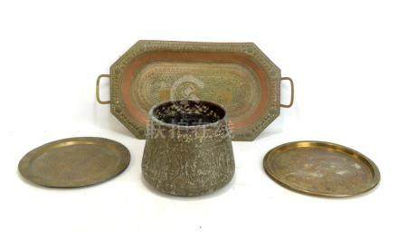 Five pieces of Eastern metalware to include an Indian copper tray and a brass tray decorated with