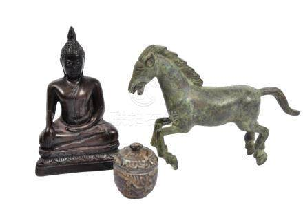 A wooden Buddha figure with carved features, 12.5 cm, together with a bronze horse, 12 cm and a