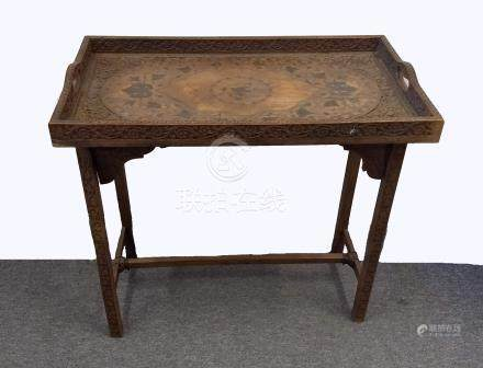 An Indian wooden and brass inlaid twin-handled tray on stand, tray with central bird medallion