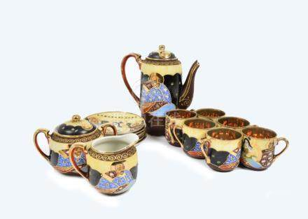 A 20th Century Japanese tea service, consisting of six cups and saucers, sugar bowl, milk jug and
