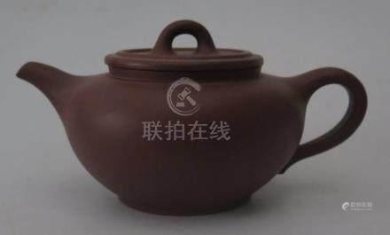 A Chinese Yixing Terracotta Teapot, 17.5cm long