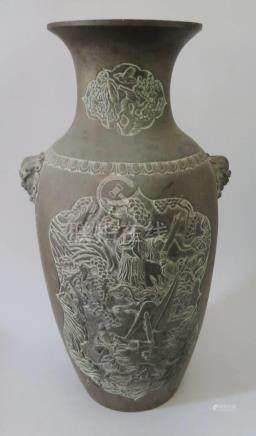 A Large Chinese Bronze Vase decorated with mythological scenes and with Shishi mask handles, six