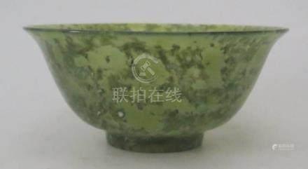 A Chinese Spinach Green Jadeite Bowl, 12.5cm diam.