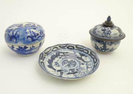 A Chinese blue and white lidded pot decorated with figures in a natural landscape,