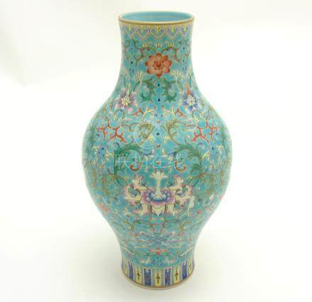 A Chinese Famille Rose turquoise-ground cloisonné-imitation vase, with round bulbous body to centre,