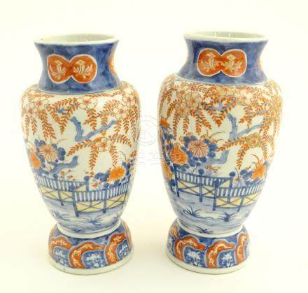 "Two Imari vases depicting a garden landscape. Approx. 12"" high."