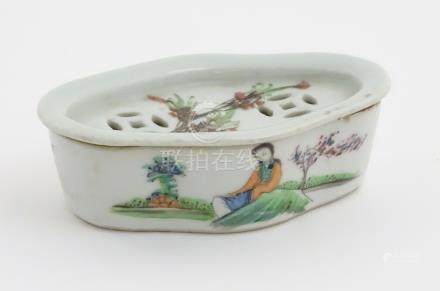 A Chinese lozenge lidded dish hand painted with 4 character markings and a figure in a landscape to