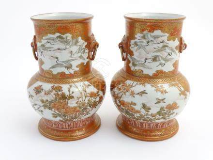 A pair of Japanese Kutani vases, decorated with cranes,
