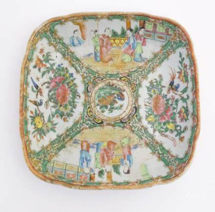 A Cantonese famille rose square dish with hand painted decoration in panels depicting figures,