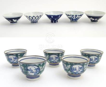 Five oriental rice bowls with blue and white pattern decoration,