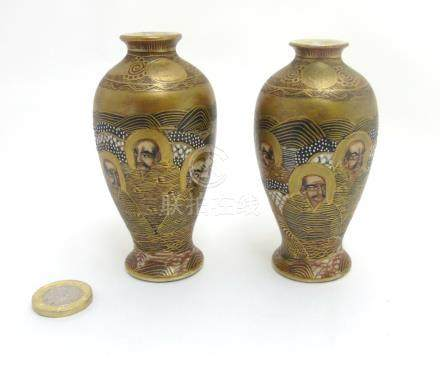 A pair of miniature Japanese Satsuma baluster vases decorated with figures with gilt highlights ,