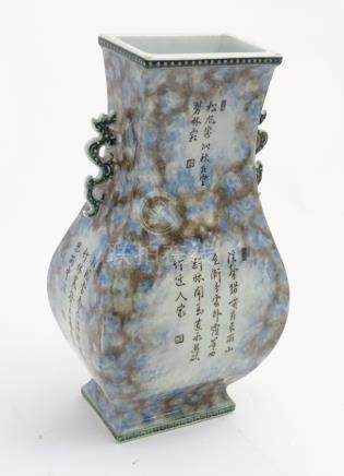 A Chinese fanghu vase with a mottled blue and grey ground and Chinese character decoration,