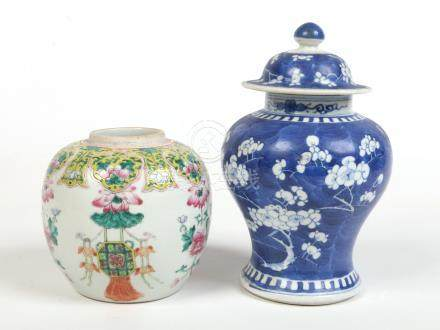 A 19th century Chinese famille verte ginger jar painted with a yellow ground collar containing lotus
