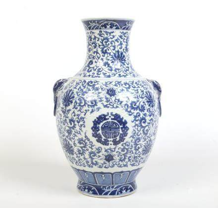 A 20th century Chinese twin handled baluster shaped vase. Painted in underglaze blue with heaped and