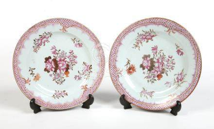 A pair of 18th century Chinese famille rose plates. With scale and feathered borders and decorated