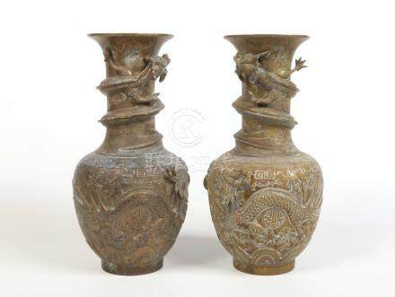 A pair of 19th century Chinese bronze vases. Moulded with dragons chasing flaming pearls. Six